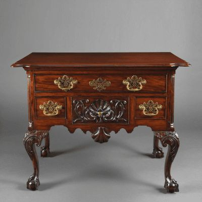 An Important Chippendale Lowboy With A Carved Shell By