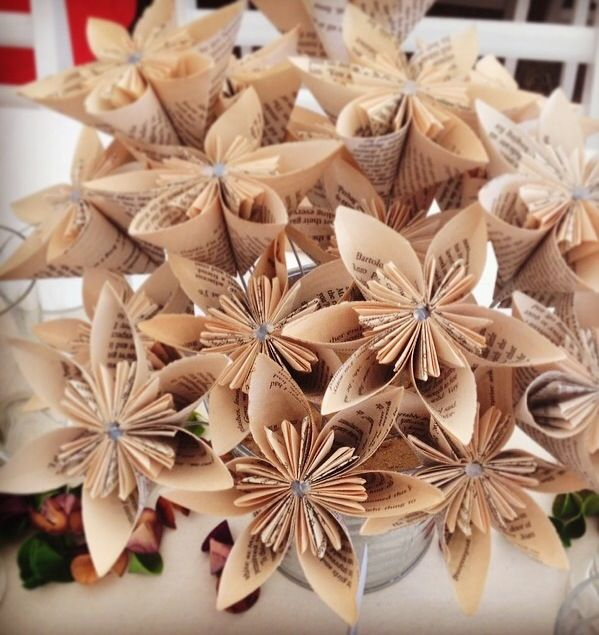 Rustic wedding. Handmade paper flowers. Pages from novels. Table centre piece