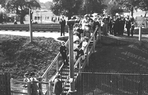People crossing the Dudding Hill railway line, at the eastern end of Dudding Hill station, and the western end of Gladstone Park