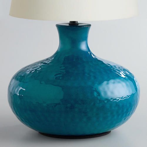 From WorldMarket.com: Blue Potted Accent Lamp Base - this would look striking against our dining room's red walls - RM