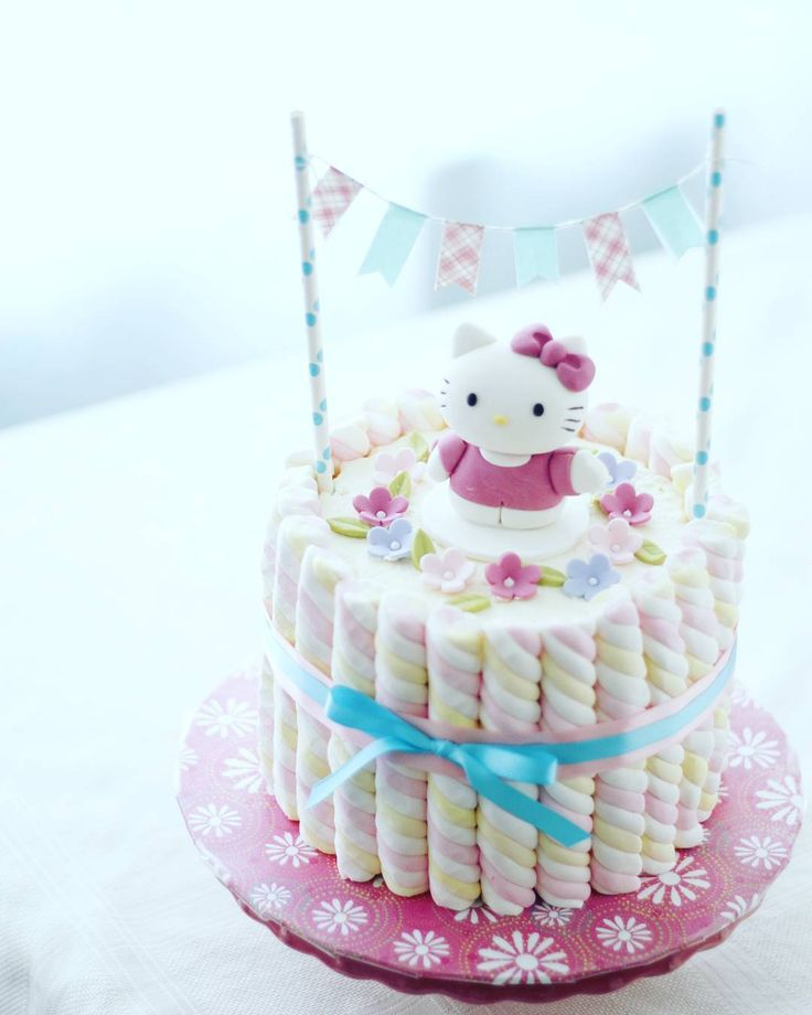 It's my niece's 4th birthday today and her request is a Hello Kitty cake. I've been dying to use these marshmallows on a cake and I finally got my chance. I think it came out cute and I love how super easy it was to make. The longest part of this cake was making the Hello Kitty fondant topper. Happy birthday my sweet K! #hellokittycake #marshmallows #hellokittybirthday