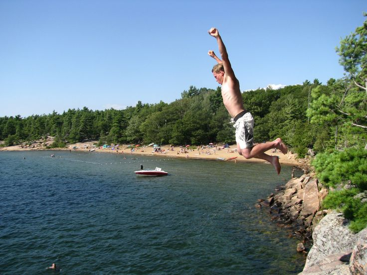 Jumping off cliffs at Harold's Pt.  For perspective, look how small the swimmer in the water looks.