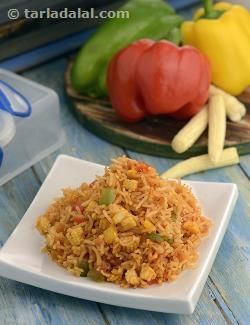 The Baby Corn and Capsicum Rice is so colourful that kids will immediately yearn to dig their spoons into the tiffin box when they see it! Not only is it visually appealing, but it appeases the appetite too as it contains a wholesome combination of rice and vegetables, flavoured excitingly with tangy tomato ketchup. This tiffin treat is very kid-friendly as it uses just a dash of pepper and chilli powder for spice, rather than chunks of ginger or green chillies that could bring tears to the…