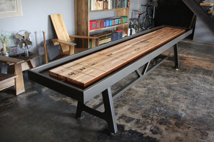 District MFG Shuffleboard Table  Table games don't need to make your home look like the common area of a frat house — they can actually look great, and the District MFG Shuffleboard Table ($5,200) certainly does.