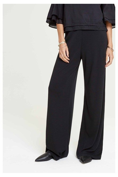 These pants flatter your curves in all the right places. They're beautifully cut from TENCEL® & Organic Cotton for an ultra wide leg shape that'll lightly graze the floor when teamed with heels. These trousers have an elasticated waist for a comfortable fit. Try yours with the Maliya beaded blouse.