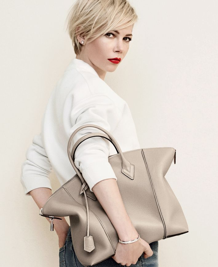 Love the neutral color. This is one you can't go wrong with! - Michelle Williams with the Louis Vuitton Lockit Handbag.