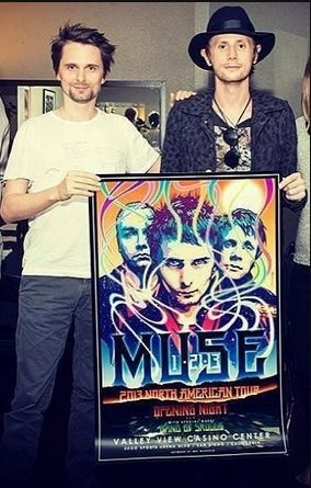 Matt & Dom holding the 2013 North American Tour poster