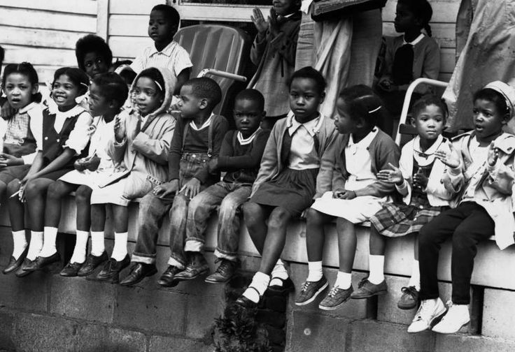 Iconic images of the civil rights movement:March 1965:  Children watching a black voting rights march in Alabama. Dr Martin Luther King led the march from Selma, Alabama, to the state capital in Montgomery.  (Photo by William Lovelace/Express/Getty Images)