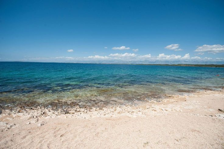 Enjoy along the coast of Punta Skala the natural stone beach with crystal-clear seawater.