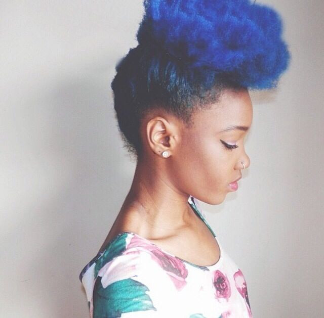 Blue - I have a picture of this same young lady in my cell from over a year ago… Talk about style genius.