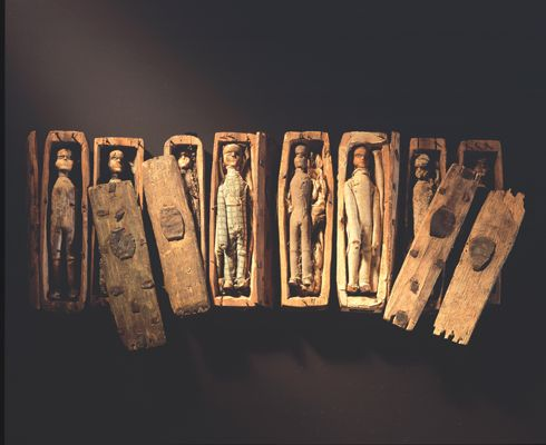 Mysterious~ In June 1836 five young boys, hunting for rabbits on the north-eastern slopes Arthur's Seat, Edinburgh, found 17 miniature coffins hidden inside a cave.    They were arranged under slates on three tiers, two tiers of eight and one solitary coffin on the top. Each coffin, only 95mm in length, contained a little wooden figure, expertly carved with painted black boots and custom made clothes.