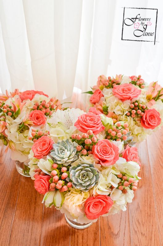 Calgary Bridal Bouquet of white hydrangea, coral roses, peach hypericum berries, succulents & white alstroemeria! Created by Calgary Wedding Florist: Flowers by Janie www.flowersbyjanie.com