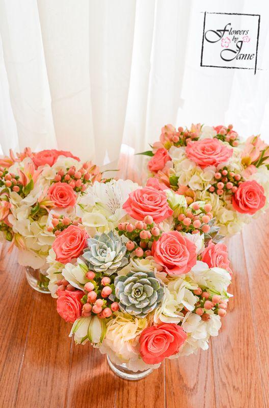 Calgary Bridal Bouquet of white hydrangea, coral roses, peach hypericum berries, succulents & white alstroemeria! Created by Calgary Wedding Florist: Flowers by Janie www.flowersbyjanie.com