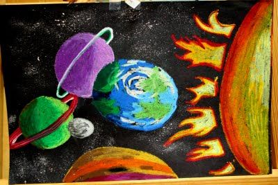 outer space- oil pastels on dark paper. (image from the smART class blog)