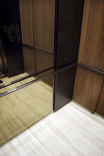 elevator detail, handrail, mirror, wood panel, reveal