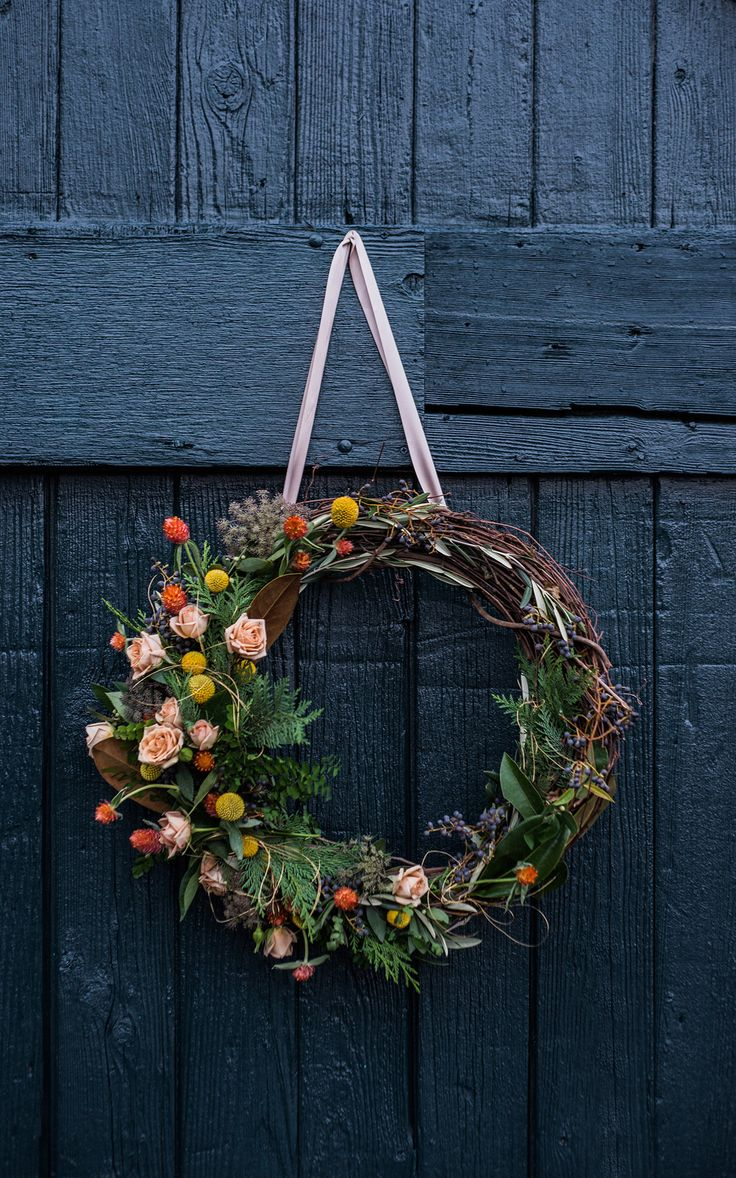 """A traditional, round wreath does not necessarily have to scream """"Hello Holidays!"""" While we love simple fresh greens as much as the next house down the street, we've created a beautiful, alternative wr"""