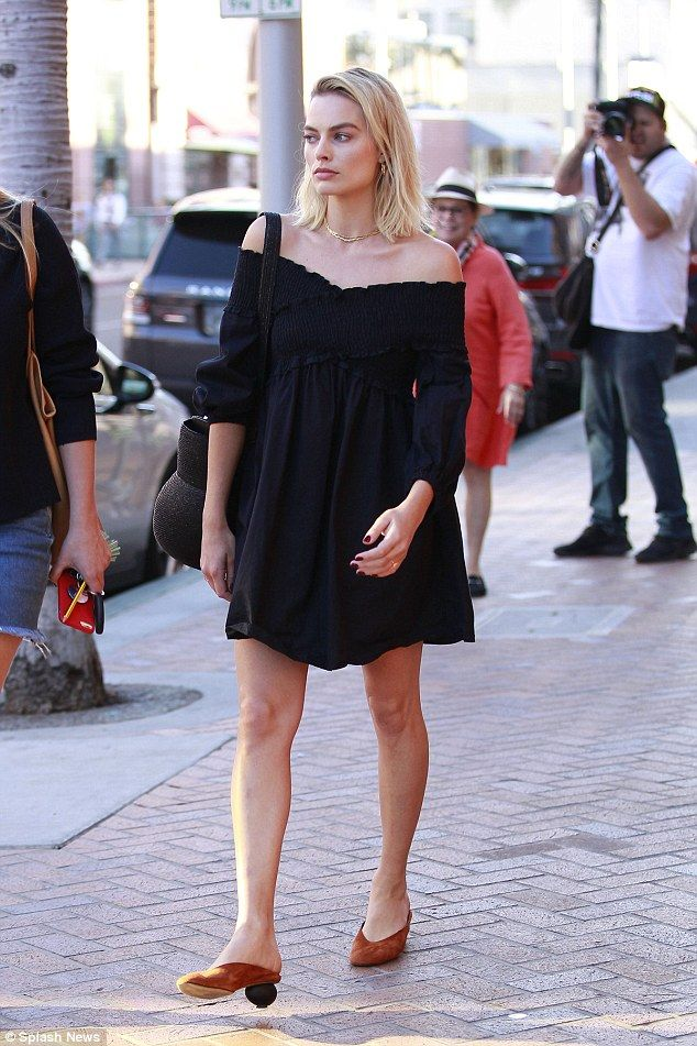 Simply stunning! Makeup free Margot Robbie flaunts her trim pins in a black dress while ou... #celebrities #margotrobbie
