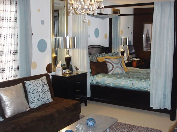 This contemporary teen bedroom has a place to hang out with friends and a curtain around the bed for when it's time to rest. The brown and blue tones add sophistication to the room.
