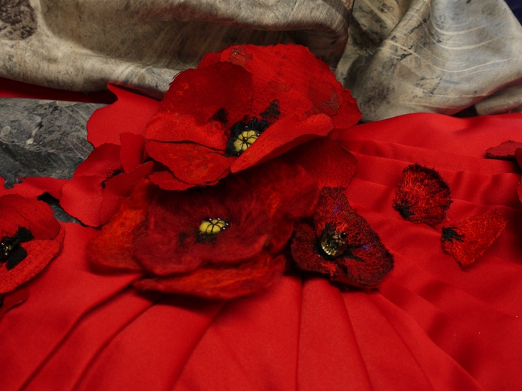 In Memory Gown - Detail of Gowns pleat work, embroidered & laser cut Poppies and digital printing