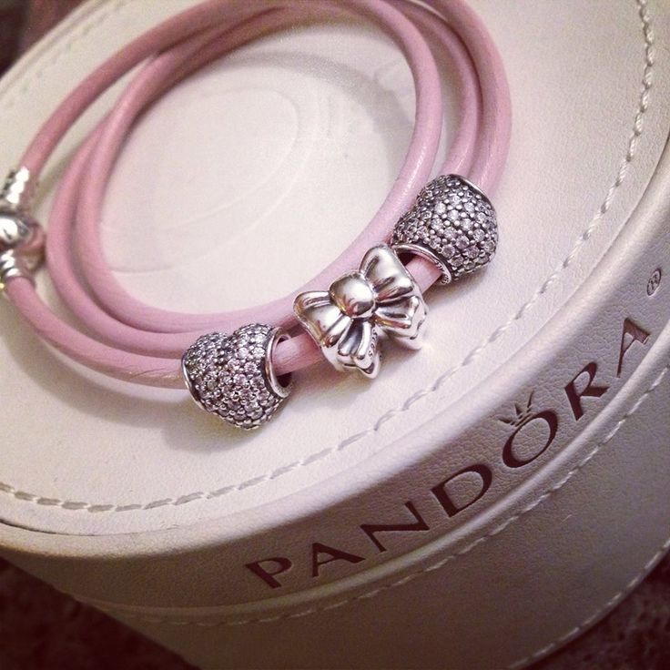 PANDORA Pink Triple Leather Bracelet with Pink Heart Pave and Bow Charm.