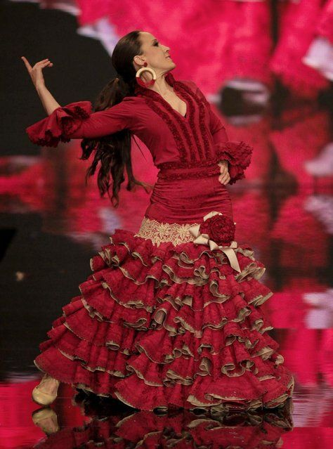 A model poses backstage during the International Flamenco Fashion Show in Seville, Spain, on February 2, 2013. (Photo by Associated Press/Miguel Angel Morenatti)