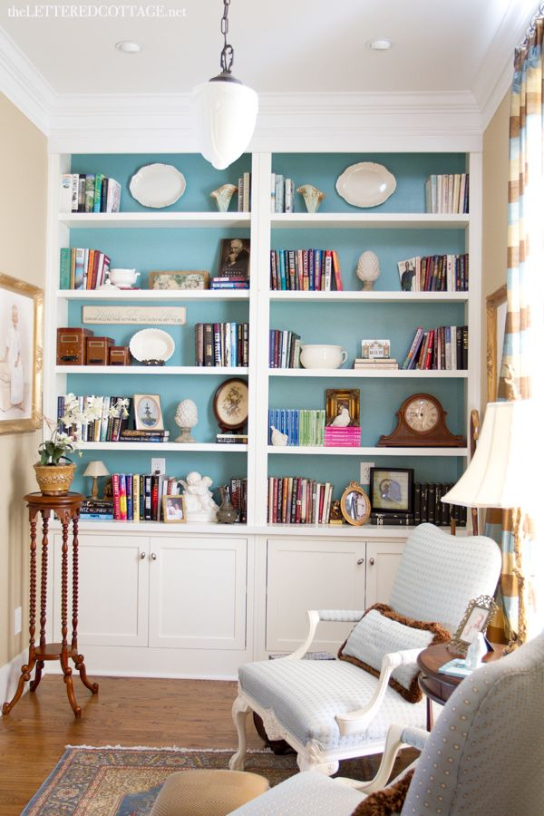 cheerful aqua paint inside built-in bookcases