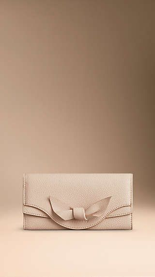 Knot-Detail Grainy Leather Continental Wallet - continental wallet in grainy leather with hand-tied knot motif and a foldover press-stud closure. Find the perfect gift this festive season at Burberry.com #burberrygifts #christmas