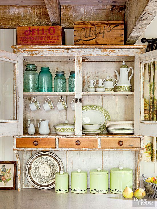 Be creative! Setting capacious wooden boxes, packing crates, and harvest baskets atop cabinets serves a number of purposes. The containers enhance vintage designs, supply eye-catching graphics and patinas, and hold everything from paper party goods to kitchen linens.
