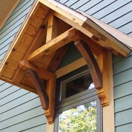 Cedar portico over window with cedar brackets and gable for Cedar gable brackets