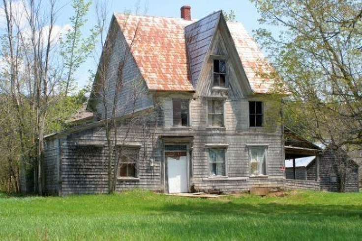 spooky, broken down, abandoned house in  a rural property