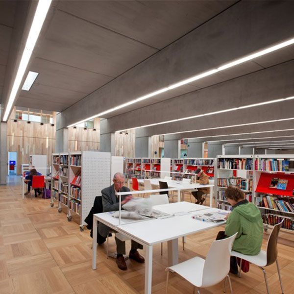 . The reading room is open plan, lit from above by means of staggered roof lights with glass vertical planes on the north face bouncing and reflecting the southern light.