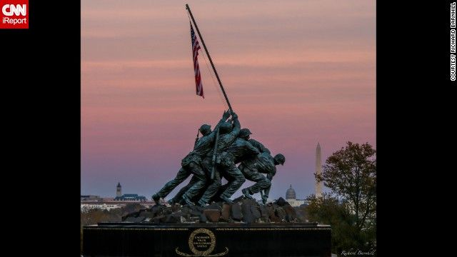 """As the sun set around Washington, D.C.,Richard Barn hill caught this shot of the Marine Corps War Memorial against the pink fall sky. The Marine Corps War Memorial inscription reads: """"In honor and in memory of the men of the United States Marine Corps who have given their lives to their country since November 10, 1775."""""""