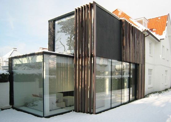 Blocky wood passive solar. Mix of black, white and wood.