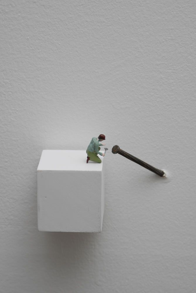 """weeklyartist: """" Liliana Porter """"Forced Labor (Nail)"""" Figurine on wooden base and nail on wall 2008 """""""