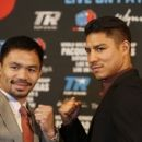 Manny Pacquiao puts retirement on hold takes on Vargas (The Associated Press)