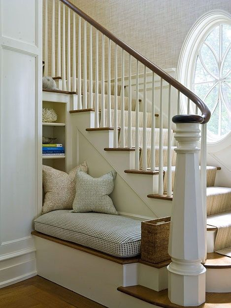 From Chic Coastal Living, a welcoming bench and place to pull off shoes at the base of a foyer staircase.