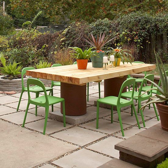 Chimney flues form the legs of this modern picnic table. To find some like it, visit a masonry supply store. Be sure to ask for hard-fired terra-cotta. To achieve the right height for comfortable seating, you may want to set a 4-6-inch stone block under each flue. Flue pipes typically come in 24-inch-long segments.