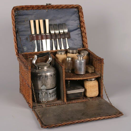 A Victorian Picnic Set, including knives, forks and food containers in a fitted wicker basket, retailed by Drew & Sons, Piccadilly Circus, with silver plate mounted fittings by Garrison. Height 10 x width 15 1/2 x depth 10 1/2 inches.
