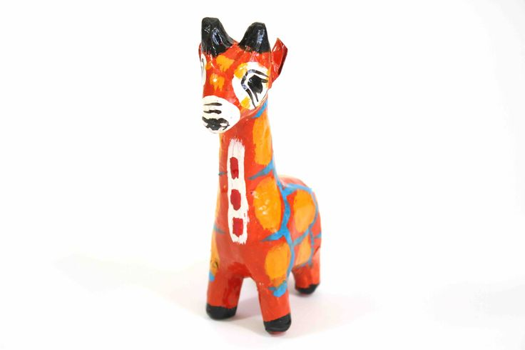 Papier-Mache Giraffe (Small): A unique This handcrafted paper-mache giraffe was made using recycled newspaper.  Each one is hand painted making them all unique and individual.  It is sure to add colour and happiness to the room.