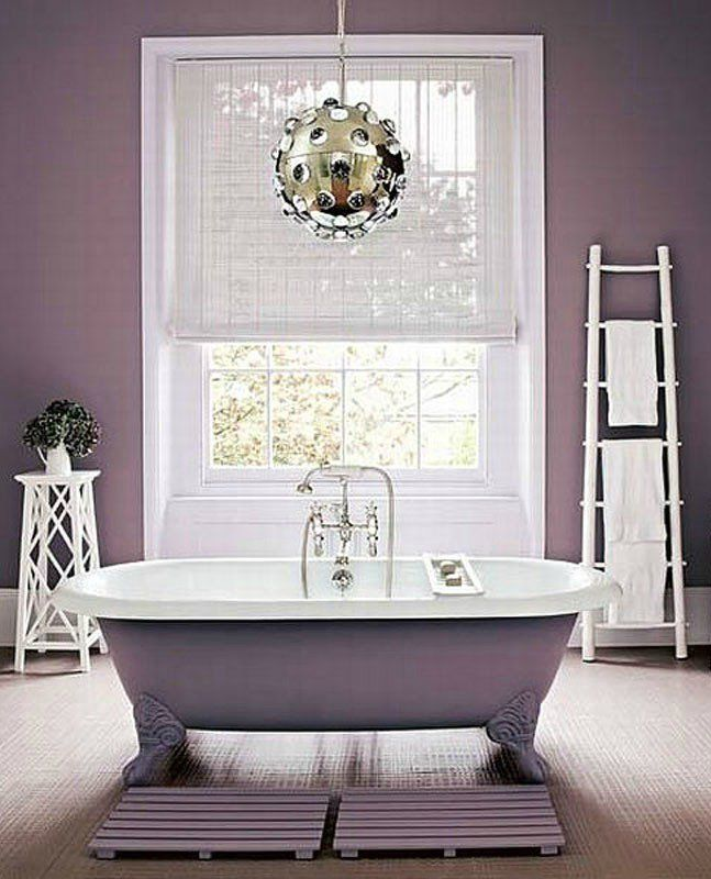 Elegant mauve bathroom with clawfoot bathtub in the same shade