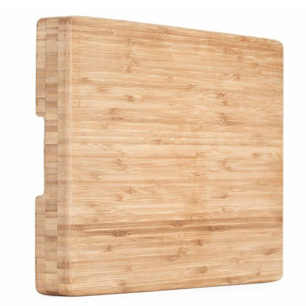 Hand Crafted from sustainable bamboo, this gorgeous end-grain cutting board is designed to resist stains, odors, and warping. Makes an elegant serving tray too! This beautifully crafted butcher block/ serving tray will put your old wood & plastic cutting boards to shame! Made of renewable bamboo, this lovely board makes the perfect cutting surface for veggies, fruits, breads, cheeses, and more. It's made with the bamboo oriented horizontally along the grain. This not only gives t...
