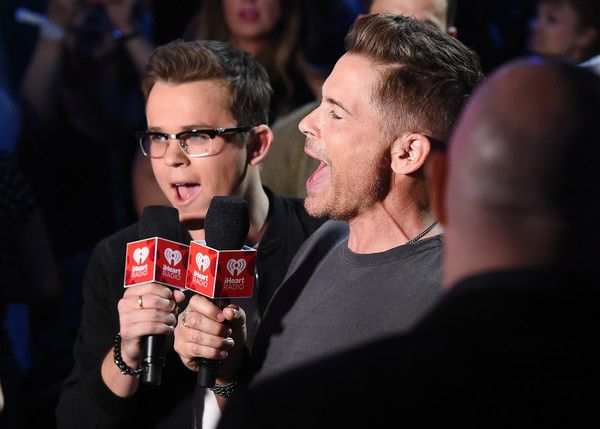 John Owen Lowe Photos Photos - John Owen Lowe (L) and Rob Lowe speak onstage during the 2017 iHeartRadio Music Festival at T-Mobile Arena on September 22, 2017 in Las Vegas, Nevada. - 2017 iHeartRadio Music Festival - Night 1 - Show