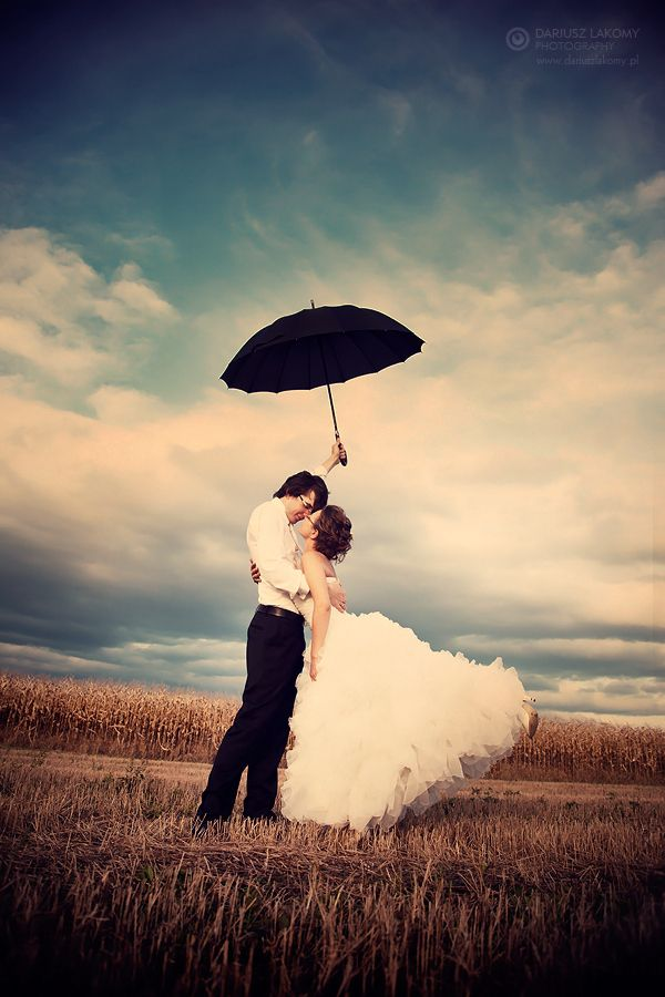 What a simply lovely shot! Umbrellas make great props for weddings and photo shoots.