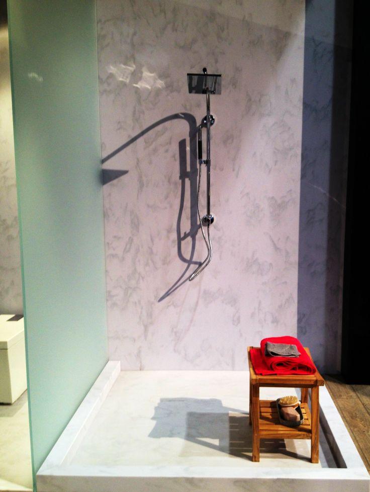 Open, big white shower in Corian® Luna White.