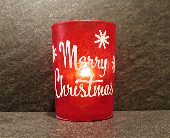 Merry Christmas Red Large Votive Candle Holder with Candle  This bright red candle holder has Merry Christmas on the front with a few snowflakes done in white. Great small gift for a teacher or friend.  This candle holder is made with a very nice quality glass tumbler. It measures 4