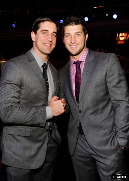 Aaron Rodgers & Tim Tebow. i dont care what people say about tebow- he is so super sexy it doesnt even matter!!!