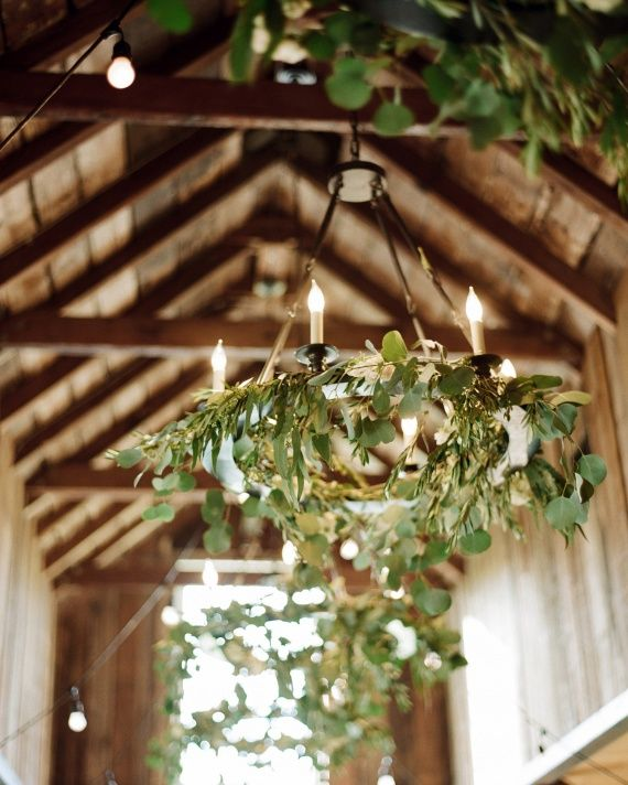 Wreaths are not only a classic Christmas decoration, but also a symbol of everlasting love. Spruce up the ceilings and chandeliers of an event space with eucalyptus wreaths, like these ones created by Branch Design Studio.