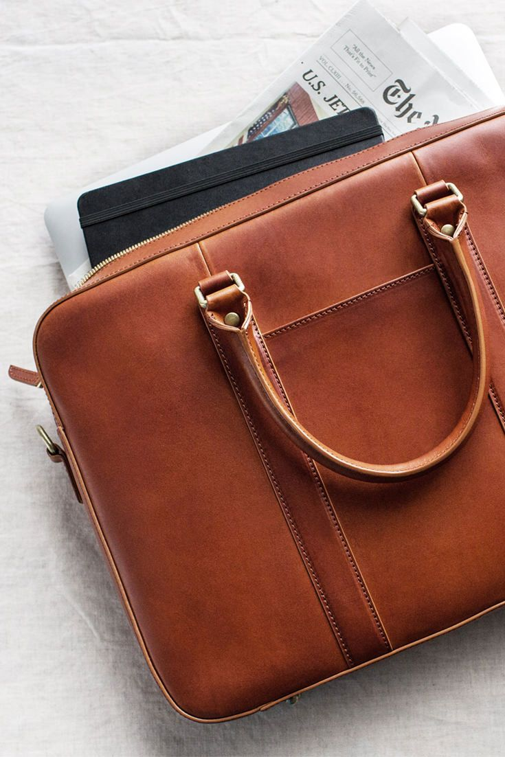 """Our bestselling slim leather briefcase, crafted from 100% full grain vegetable-tanned leather. Fits a 15"""" MacBook and comes with an adjustable shoulder strap."""