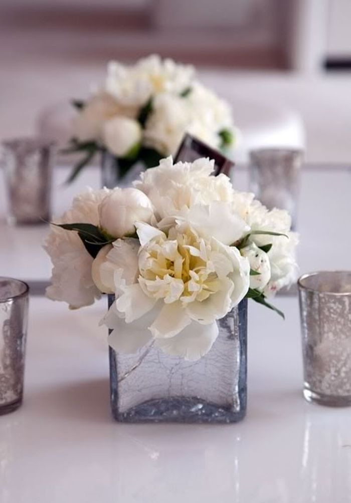 simple peony centerpieces with votives. love the mercury glass