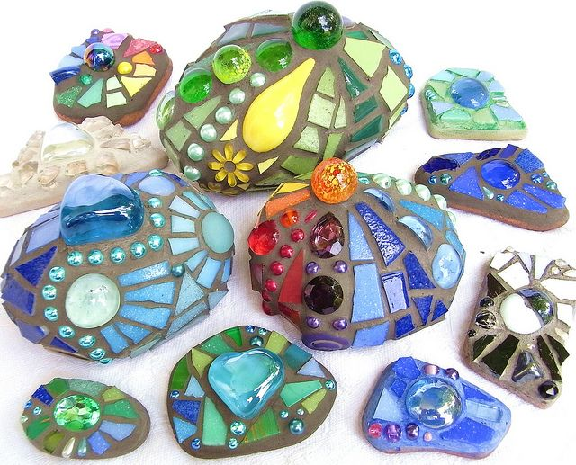 mosaic stones - gorgeous for the garden! what a great project for found objects, little toys, marbles, jacks . . . .
